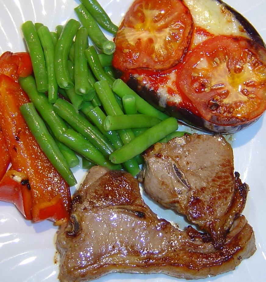 Pork chops and vegetables on a plate